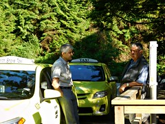 Grouse Mountain visitor center, North Vancouver, British Columbia, Canada (Comiccreator24) Tags: taxi taxidrivers candidphotography toyota corolla toyotacorolla britishcolumbia people peoplephotography taxicabs vancouver vancouverbc nikonography nikon twopeople conversation peopletalking