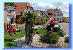 ...On the seesaw... (Explored) (cegefoto (temporarily less active)) Tags: frankrijk france elzas elzace klederdracht garb wip seesaw decoration decoratie 117in2017 childishdelights