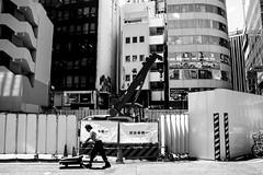 At Work 仕事中 (Shutter Chimp: Im back!) Tags: 渋谷 日本 ビル 道路 東京 渋谷区 japan shibuya building tokyo road street photography person 人 push 押す construction 建設 仕事中 クレーン crane crain モノクロ モノクロ写真 bw black white mono monochrome trolley 台車 urban アーバン