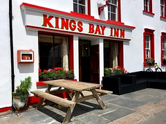 Kings Bay Inn (JulieK (thanks for 5 million views)) Tags: arthurstown wexford pub window bench hbm red colourful flowers ireland irish iphonese sign