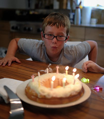 Counting ten candles (Lars Plougmann) Tags: birthdayparty party birthday cake candles dscf1785