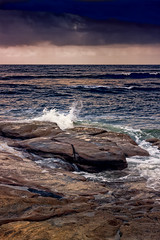 Waves Splash On The Rocks At Sunset (k009034) Tags: 500px sky landscape sea sunset water reflection nature beach travel clouds ocean rocks evening splash seashore outdoors scenic no people person australia queensland pacific copy space caloundra destinations teamcanon