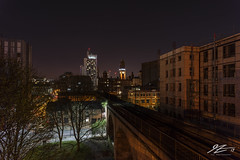 Watch Yourself (Tim van Zundert) Tags: manchester greatermanchester railway urban northwestengland building architecture city cityscape night evening longexposure cloud sony a7r voigtlander 21mm ultron train trees