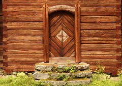 The door of wilderness-church (irio.jyske) Tags: wilderness wilderneschurch church timber nature stones door peace grass colors brown grey green bibel religion building house canoncamera canonlens