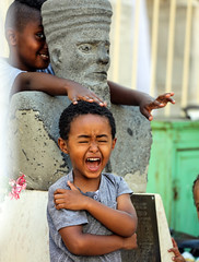 """for the imagination of man's heart is evil from his youth"" (ybiberman) Tags: israel jerusalem citycenter ethiopianchurch boy cry smile sculpture hide portrait candid streetphotography"