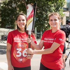 Miranda Issacs handing to Emily Beyko (2017 Canada Games // Jeux du Canada 2017) Tags: keithlevitphotography tor canadasummergames emilybeyko mirandaissacs winnpegtorchrelay