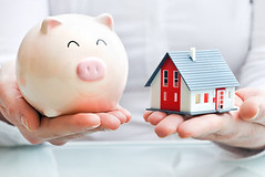 Hands holding a  piggy bank and a house model (Yhousetw) Tags: bank banking money save savings business piggybank collect concept loan investing credit investment income safe finance retirement holding piggy moneybox financial show realtor realestate home sale buying house financing sell property agent industry selling ownership purchase hands buy offer possession homeowner purchasing owner residential concepts wealth strategy mortgage planning germany