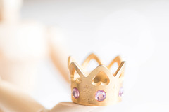 Fit for a Queen (judi may) Tags: macromonday macro macromondays queen crown jewels mannequin woodenmannequin manny highkey dof depthoffield bokeh white whitebackground negativespace