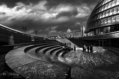 Meeting place (Alec_Hickman) Tags: london city cityhall towerbridge steps people buildings architecture cityscape light shadow monochrome blackandwhite noiretblanc englandbritain clouds windows bridge