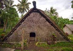 A traditional meeting place called a nakamal where takes place the kava ceremony, Malampa Province, Malekula Island, Vanuatu (Eric Lafforgue) Tags: a0010642 anthropology colourimage community cultures developingcountries fulllength grass horizontal hut indigenousculture island kava malakula malampaprovince malekulaisland mallicolo meetingplace melanesia nasara newhebrides nonurbanscene oceania outdoors pacificislands photography rough ruralscene rustic simplicity southpacific statue straw thatchedhut thatchedroof tourism tradition traditionalculture traveldestinations tribal tribe vanuatu vut