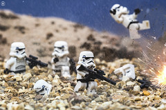Trooper Sand Battle (jezbags) Tags: lego legos toys toy minifigure minifigures macro macrophotography macrodreams macrolego canon60d canon 60d 100mm closeup upclose starwars star wars troopers trooper stormtrooper stormtroopers explosion flying war battle bang sand rock sky beach death rip dead helmet guns gun troop