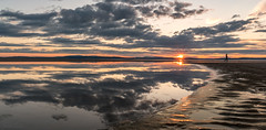 Walk on by (Derek Coull) Tags: nairnbeach sunset reflections silhouette sea sand sun sunflare scotland highlands