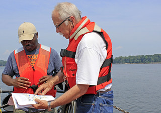 Regulatory team members, partners look at aquaculture projects