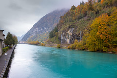 Lake Aare in Interlaken Switzerland (Rezwanul Islam (REZ1)) Tags: interlaken bern switzerland ch blue green water hills trees autumn 2015 cloudy overcast lake flowing canon 600d
