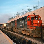 CONRAIL WB. VAN TRAIN WITH LEASED CN UNITS ROLLS PAST THE AMTRAK STATION - CLEVELAND, OHIO - SEPTEMBER 1976 thumbnail
