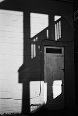 R1-E023 (David Swift Photography Thanks for 22 million view) Tags: davidswiftphotography newjersey doors shadows oceancitynj walls porches olympusstylusepic ilfordxp2 35mm film