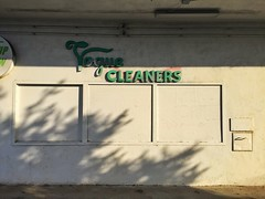 Sooo Last Season (misterbigidea) Tags: vogue cleaners lettering outofbusiness closed empty building green letters laundry city neighborhood scenic beauty mundane afternoon shadows white wall drycleaning sign urban shapes abstract clean blank
