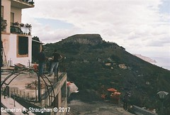 CNV00007s (Cameron A. Straughan) Tags: travel tourism eccentric quirky surreal odd architecture street history angles lines culture 35mm exposures film developing 400 iso real photography traditional photographs fuji stx2 camera processing tamron zoom lens 35 mm manual colour color photos classic old school ilford taormina hill mountains sicily mount etna active volcano teatro antico di ancient greco¬roman godfather francis ford coppola italy