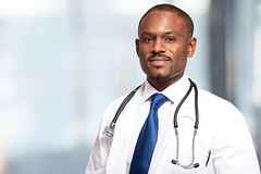 My Doctors (yellowstone-technologies) Tags: doctor hospital medical physician medicine clinic stethoscope medic professional people person trustworthy doctoring healthcare health care man male handsome patient aid cardiologist trust help exam black afro african smile smiling friendly adult mature 30s 40s blue blurred background copyspace unitedstatesofamerica