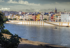El Color de Triana y la calle Betis. The Color of Triana and Betis Street. (Capuchinox) Tags: españa spain andalucia andalusia sevilla seville triana betis guadalquivir rio river cielo sky nubes clouds color olympus hdr photomatix dodgeburn casas houses patos ducks barco boat