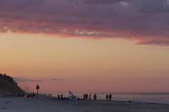 Bonfires Under SkyFire (brucetopher) Tags: sunset sea beach water ocean coast coastal seacoast pink sky clouds cloud purple reflection skies guard tower lifeguardtower lifeguard wave surf ripples people groups man woman kids family families vacation holiday girl boy children playing play