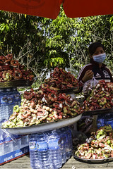 Tamarind vendor (Keith Kelly) Tags: asia cambodia kh kampuchea seasia southeastasia tamarind food fruit ontheroad road snack stall street transportation vendor