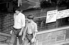 h42-68 01 (ndpa / s. lundeen, archivist) Tags: nick dewolf nickdewolf bw blackwhite photographbynickdewolf film monochrome blackandwhite city summer 1968 1960s 35mm boston massachusetts candid streetphotography citylife streetlife people beaconhill charlesstreet sidewalk pedestrian youngpeople july sunday weekend july28 pedestrians storefront business man youngman men youngmen window storewindow restaurant sign signs special specials charlesstreetsteakhouse steps stairs charbroiled tasty swordfish barbecuedchicken choppedsirloin brunette longhair sideburns mustache moustache denim jeans 149