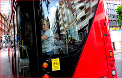 `2053 (roll the dice) Tags: london camden w1 londonist pretty glass window reflection bus travel transport traffic reaction uk art classic urban unaware unknown people natural fashion shops shopping busy crowd passenger streetphotography portrait stranger candid red mini rojo caution danger portait canon tourism tourists