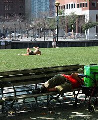 Haves and haves not. (ktmqi) Tags: hoboken newjersey hudsoncounty waterfront park homeless sunbather lawn contrast