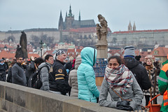 (Debarshi Ray) Tags: czech prague city charlesbridge bridge winter christmas canon canoneos70d tamron tamronaf18270mmf3563 wife girlfriend people crowd castle cathedral statue sculpture scarf sky blue brown karlůvmost building