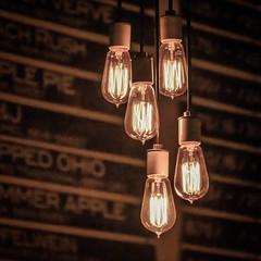 Bulbs (tim.perdue) Tags: bulbs brothers drake meadery bare bulb edison lightbulb light five fixture hanging menu wall focus depth field dof monochrome sepia bar mead columbus ohio short north minimalism