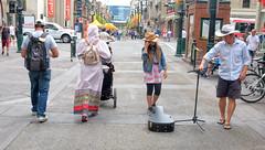 Calgary Stampede, Downtown Action (Sherlock77 (James)) Tags: calgary downtown stephenavenue calgarystampede streetphotography people man woman busker musician