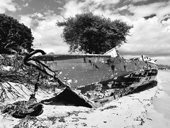 Beached and Bleached (whitehart1882) Tags: redundant sky sand decay rotten beached beach boat old