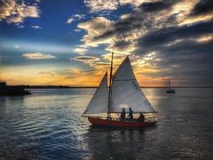 Sunset sailing (janetmeehan) Tags: boat sea pier seascape ocean sunset ireland dublin