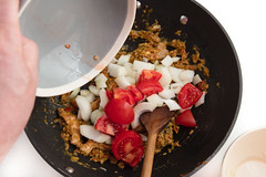 Adding chopped tomato to wok with nasi goreng ingredients. (annick vanderschelden) Tags: pork meat slices culinary domestic pic suscrofadomesticus consumed raw cooked fat texture dietary food pig cooking preparedmeat nutrition cutlet long oliveoil brown wok fried nasigoreng mix ingredients spices herb vegetables indonesia dried soak flavour preparation taste onion redpepper haricot salt aroma wheat barley coriander palmfat garlic sugar potatostarch curry mustardseed sunfloweroil hydrolizedvegetableproteins cumin maltodextrine pepper cayennepepper sesameoil soysauce shrimppowder beetextract lemonjuice pan boiling egg spoon stirring mixture tomato belgium