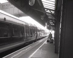 departure - Moor St (OhDark30) Tags: olympus 35rc 35 rc film 35mm monochrome bw blackandwhite bwfp fomapan 200 rodinal moorst station platform birmingham train rail railway railroad man suitcases traveller