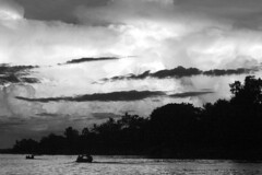 Clouds in the tropics in the evening (www.holgersbilderwelt.de) Tags: stungtreng nature beautiful light sky water travel landscape tree clouds forest river sunset reflection plant monochrome way fine botany shadow classic kunst art weather scenic silhouette tranquility season calm rural countryside traditional public peace perspective cambodia waterscape rustic alley schwarzweiss mekong