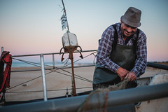 Rodrigo laughs as he call crabs small seafood (pedromfs) Tags: algarve sunrise day203 montegordo 8857209741 project365 beach 2017 fisherman