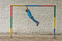 textural technicolor acrobatics (Pejasar) Tags: girl monkeybars color acrobatics textures whitewall colorful child play playground jocofút antigua guatemala escuelaintegrada