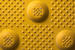 Tactile paving (lenswrangler) Tags: lenswrangler digikam rawtherapee yellow tactile tactilepaving ada macromondays texture blind visuallyimpaired