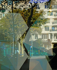 Sunshades in a store window (chrisk8800) Tags: storewindow reflections sunshades building lapedrera antonigaudí trees chrisk8800 barcelona