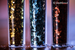 Glitter (stadtbrautphoto) Tags: glitter glitterofstarts glitterparticles glittereye materials shineandglamor sparkle funkeln glittergirls decorativematerial decomaterial decoration glitzern glistening colors colours different goldglitter shadesofglitter macromondays three package pack sealableplastictubes 3 plastictube closed closeup transparent contain innersurface soft small new bottom pipe basteln tinker crafting artsandcrafts craftwork theatre