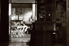 L'enoteca (No_Mosquito) Tags: vicenza veneto italia italy europe city urban bw monochrome monotone life woman enoteca pub wine dolce vita summer evening heat bar borsa chairs