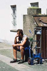 Team Blue (Thomas Listl) Tags: thomaslistl color blue human man person street sunlight analog minolta x700 fuji provia100f sitting shorts worker break afternoon 50mm
