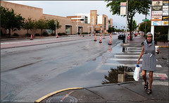 After the Rain on Old Route 66 (newmexico51) Tags: woman stripes crosswalk route66 eastcentral centralavenue gregorypeterson femme mujer unm universityofnewmexico albuquerque nm newmexico streetphotography