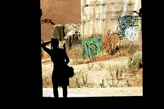 In the Doorway (LookSharpImages) Tags: silhouette dark lime limeoregon oregon abandoned abandonedspaces factory graffiti