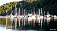 Calm moments (mootzie) Tags: tobermory scotland harbour water sea reflections mull nautical sails masts ropes white blue red