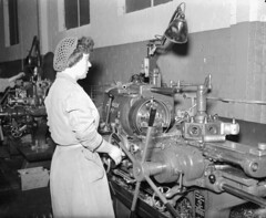 Woman operating a capstan lathe at the Elswick Works (Tyne & Wear Archives & Museums) Tags: elswickworks newcastleupontyne factory vickersarmstrongs capstanlathe industry industrial manufacturing lamp worker employee tyneside northeastengland machinery womenshistory woman unusual fascinating interesting rare c1961 blackandwhitephotograph industrialheritage digitalimage archives northeastofengland unitedkingdom workshopsoftheworld production processwork mechanical femaleemployee female operating standing working wall interior floor window glass ledge britain scotswoodworks company vickersarmstrong factories rivertyne products williamgeorgearmstrong lordarmstrong hydrauliccranes shipbuilding armaments locomotives vickersarmstrongcollection label components handle hand light uniform crease grain debris box tool attentive cord lever electrical brick bench hair