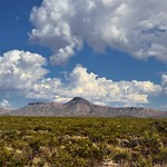 Unknown Peaks of the Tinaja Mountain Under Blue Skies and White Puffy Clouds thumbnail