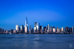 Manhattan Blue (brianloganphoto) Tags: skyline northamerica regions reflections newyork hudsonriver evening wtc skyscraper bluehour nyc newyorkcity landcape worldtradecenter unitedstates buildings landmark manhattan jerseycity newjersey us